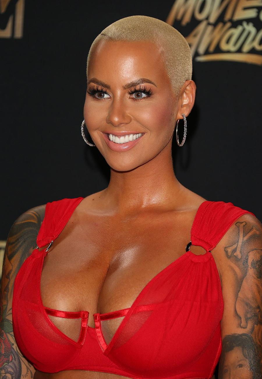 <p>Amber Rose's signature style is pefect for summer. The close crop must keep her cool all the time. (Photo: WireImage) </p>
