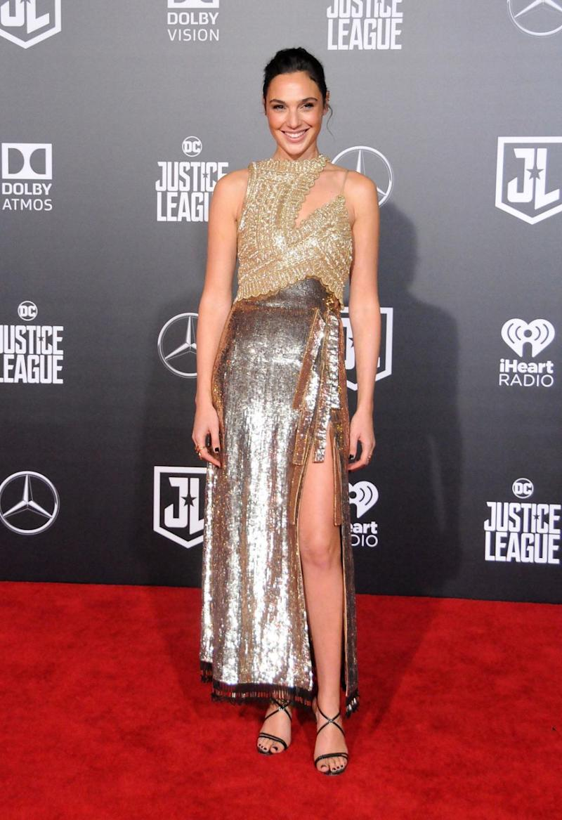 Gal Gadot made a shimmery entrance wearing a dress that was made from intricate gold glass beads. Source: Getty
