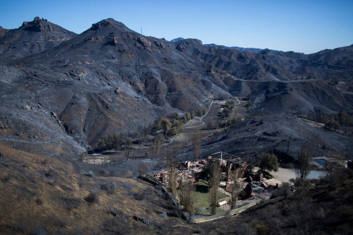 The Santa Monica Mountains are seen left blackened by the Woolsey Fire near Malibu, Calif., on Nov.14, 2018. (Photo: David McNew/AFP/Getty Images)