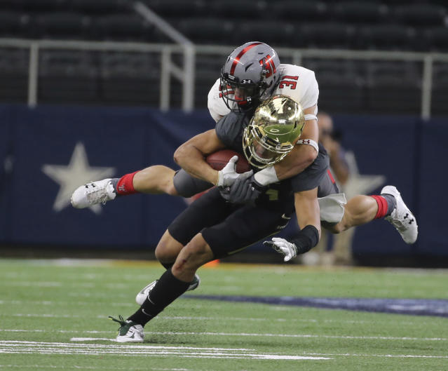 "Texas Tech's <a class=""link rapid-noclick-resp"" href=""/ncaaf/players/271540/"" data-ylk=""slk:Justus Parker"">Justus Parker</a> (31) leads the team with four interceptions. Formerly a walk-on, Parker is now on scholarship. (Jerry Larson/Waco Tribune Herald, via AP)"