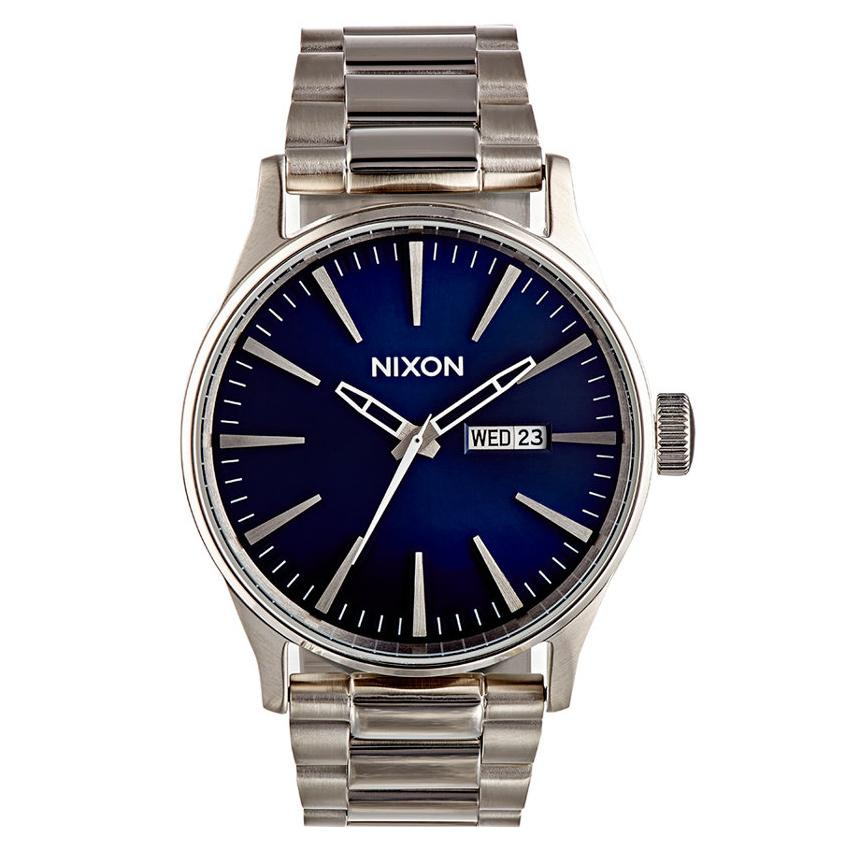 "<p>We love how the royal blue face of this Nixon watch pops against silver.</p> <p>$200 | <a rel=""nofollow"" href='http://click.linksynergy.com/fs-bin/click?id=93xLBvPhAeE&subid=0&offerid=293189.1&type=10&tmpid=12371&RD_PARM1=http%253A%252F%252Fwww.barneys.com%252Fnixon-sentry-ss-watch-504397125.html&u1=istdmenswatches'>barneys.com</a></p>"