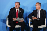 Willis Towers Watson Chief Executive Officer John Haley, left, is joined by Bank of England Governor Mark Carney as he addresses the Climate Action Summit in the United Nations General Assembly, at U.N. headquarters, Monday, Sept. 23, 2019. (AP Photo/Jason DeCrow)
