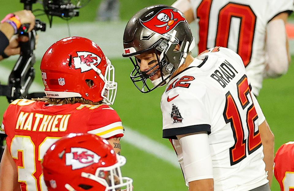 Buccaneers quarterback Tom Brady (12) speaks to Chiefs safety Tyrann Mathieu during the second quarter of Super Bowl LV. (Photo by Kevin C. Cox/Getty Images)