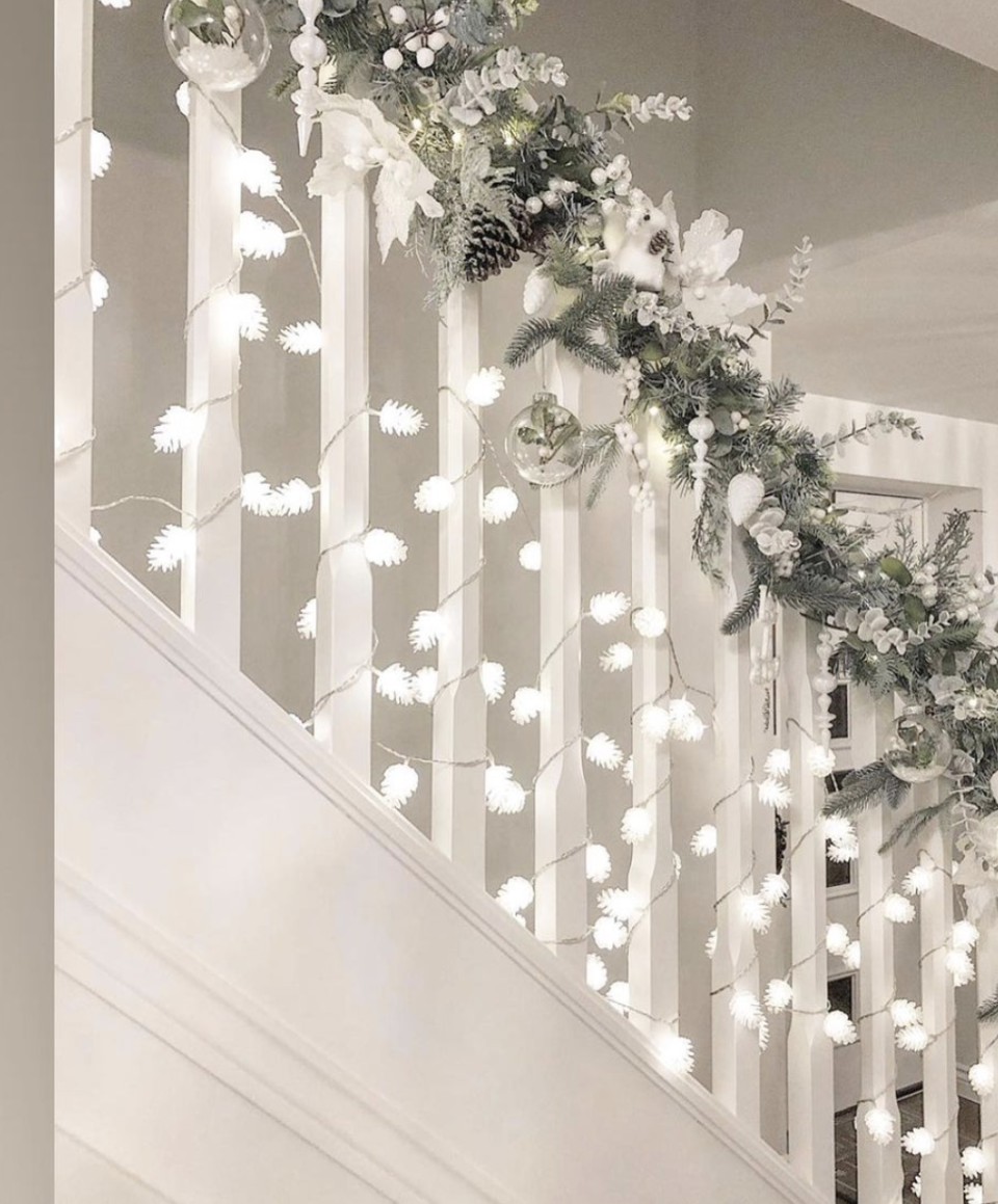 """<p>For a unique spin on traditional lights, wrap a pinecone-shaped option around each spindle. The resulting glow is nothing short of magical. </p><p><em>See more at <a href=""""https://www.instagram.com/p/CE3Xsf1HKiH/"""" rel=""""nofollow noopener"""" target=""""_blank"""" data-ylk=""""slk:gems_home"""" class=""""link rapid-noclick-resp"""">gems_home</a>.</em></p><p><a class=""""link rapid-noclick-resp"""" href=""""https://www.amazon.com/Sugared-Pinecones-Novelty-Light-Set/dp/B000QV76GY?tag=syn-yahoo-20&ascsubtag=%5Bartid%7C10072.g.34479907%5Bsrc%7Cyahoo-us"""" rel=""""nofollow noopener"""" target=""""_blank"""" data-ylk=""""slk:SHOP LIGHTS"""">SHOP LIGHTS</a></p>"""