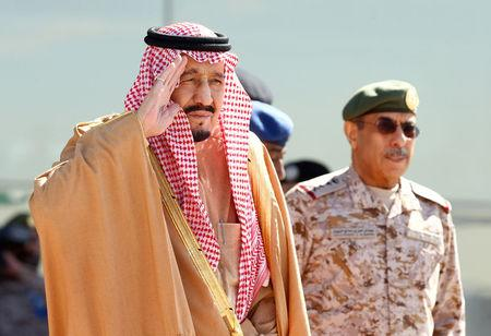 FILE PHOTO: Saudi King Salman salutes as he attends a graduation ceremony and air show marking the 50th anniversary of the founding of King Faisal Air College in Riyadh