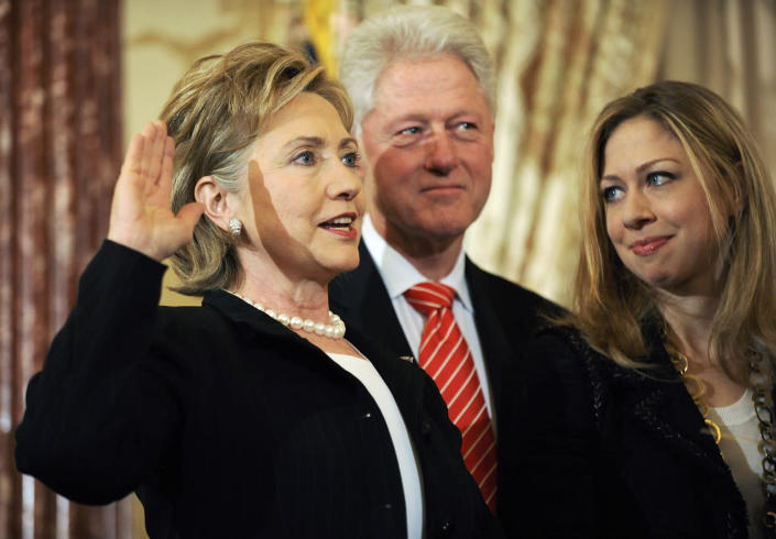 <p>Secretary of State Hillary Clinton is joined by her husband, former President Bill Clinton, and her daughter, Chelsea, as she is ceremonially sworn in at the State Department in Washington, on Feb. 2, 2009. (Photo: Jonathan Ernst/Reuters)</p>