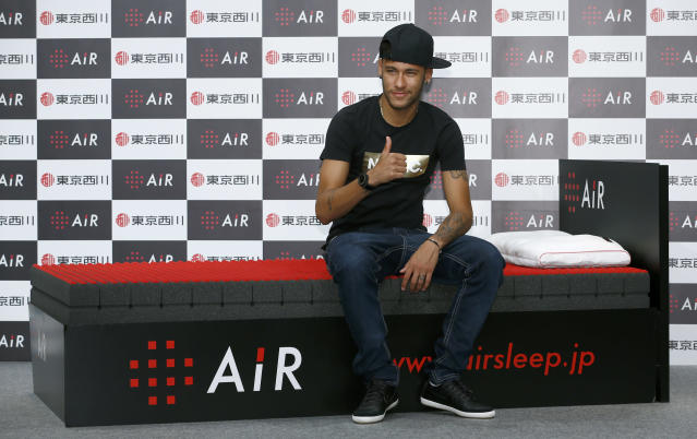 Brazil's soccer player Neymar poses for photographers during a press conference at a hotel in Tokyo, Thursday, July 31, 2014. (AP Photo/Shizuo Kambayashi)