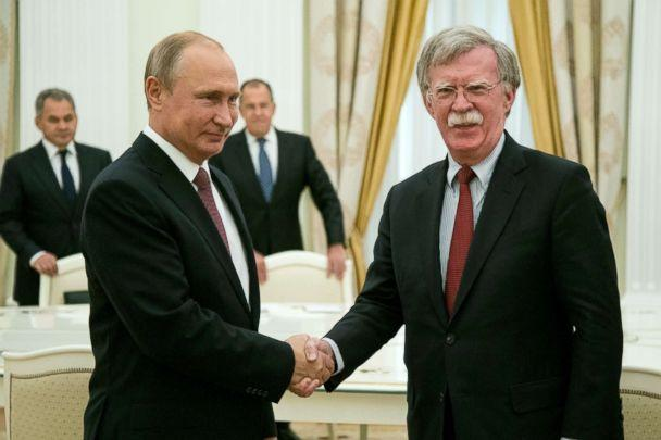 PHOTO: Russian President Vladimir Putin, left, shakes hands with US National security adviser John Bolton during their meeting in Moscow, June 27, 2018. (Alexander Zemlianichenko/EPA via Rex/Shutterstock)