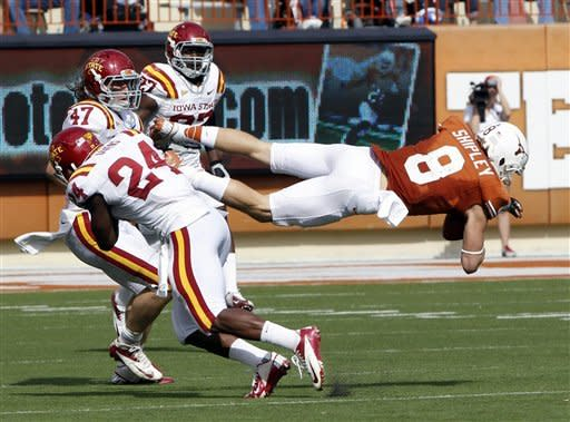Texas receiver Jaxon Shipley (8) catches a pass in the third quarter of an NCAA college football game against Iowa State defenders at Darrel K. Royal Memorial Stadium, Saturday, Nov. 10, 2012, in Austin, Texas. Texas won 33-7. (AP Photo/Michael Thomas)