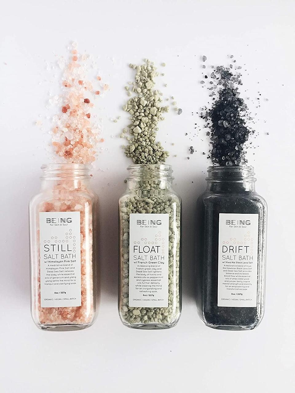 <p>Give yourself a relaxin bath with this <span>Live By Being Bath Salt Spa Gift Set Collection</span> ($56). It comes in a variety of mineral-rich salts like Himalayan pink salt, French green clay and dead sea salt, and Hiwa Kai black lava salt. </p>