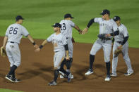 New York Yankees celebrate an 8-4 win over the Toronto Blue Jays in a baseball game Thursday, June 17, 2021, in Buffalo, N.Y. (AP Photo/Jeffrey T. Barnes)