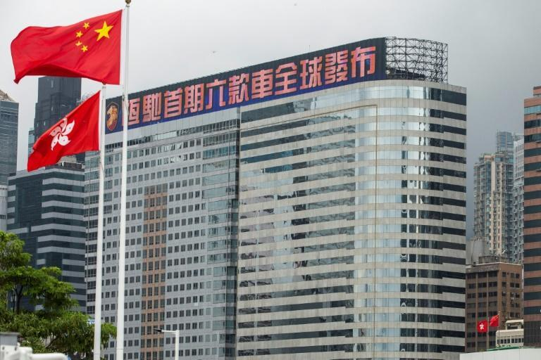 China Evergrande has tried to sell off assets to meet help pay its debts, including its Hong Kong headquarters (AFP/ISAAC LAWRENCE)