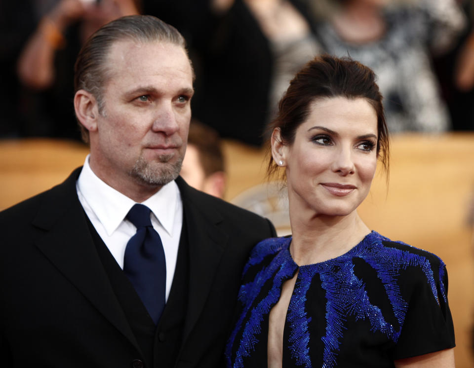 Sandra Bullock, right, and Jesse James arrive at the 16th Annual Screen Actors Guild Awards on Saturday, Jan. 23, 2010, in Los Angeles.  (AP Photo/Matt Sayles)