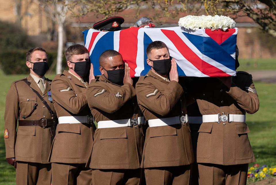 The coffin of Captain Sir Tom Moore is carried by members of the armed forces during his funeral at Bedford Crematorium. (Photo: PA Images / Joe Giddens)