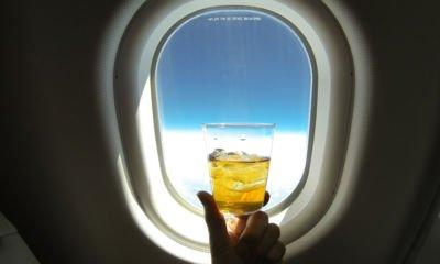 Drinking duty-free booze on planes 'should be a criminal offence'