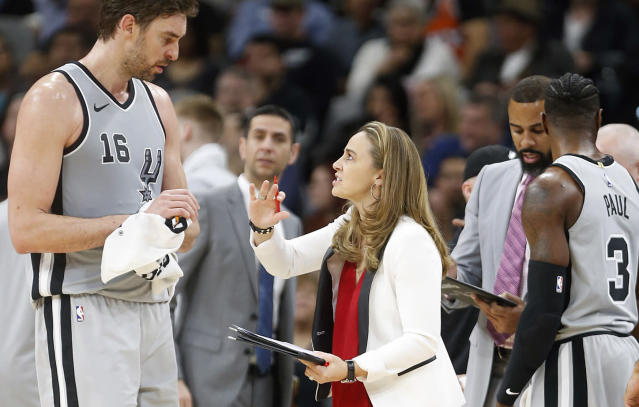 "<a class=""link rapid-noclick-resp"" href=""/nba/teams/sas"" data-ylk=""slk:Spurs"">Spurs</a> assistant coach Becky Hammon goes over the game plan with San Antonio's <a class=""link rapid-noclick-resp"" href=""/nba/players/3513/"" data-ylk=""slk:Pau Gasol"">Pau Gasol</a>. (Getty Images)"