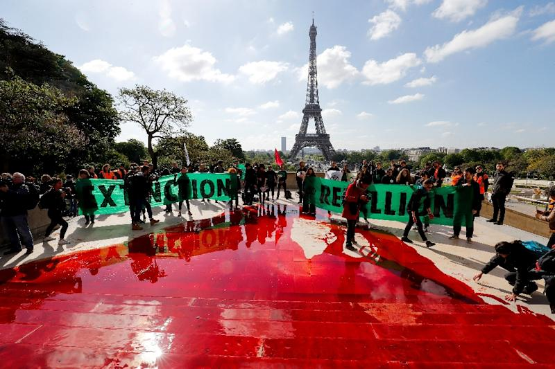 Climate activists spilled fake blood on the famous Trocadero esplanade opposite the Eiffel Tower