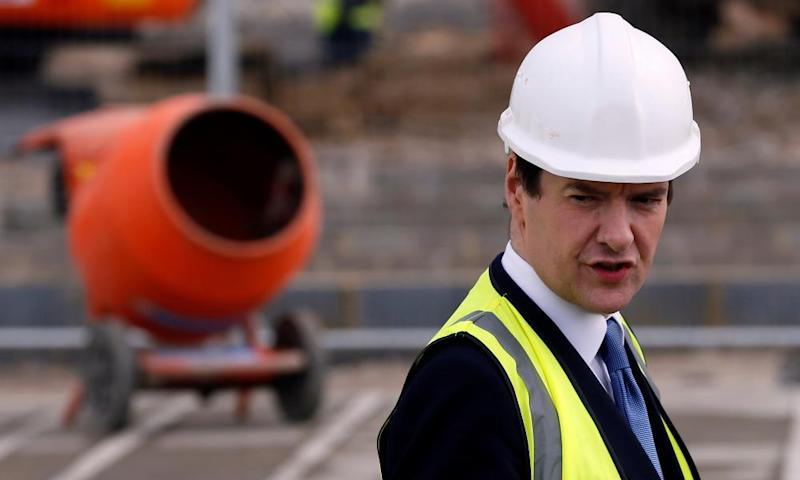 Britain's chancellor of the exchequer George Osborne visits the construction site for the Ebbsfleet Garden City, in 2014.