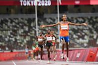 Sifan Hassan produced a devastating kick finish to win the 5,000m, the first of an audacious treble she is attempting