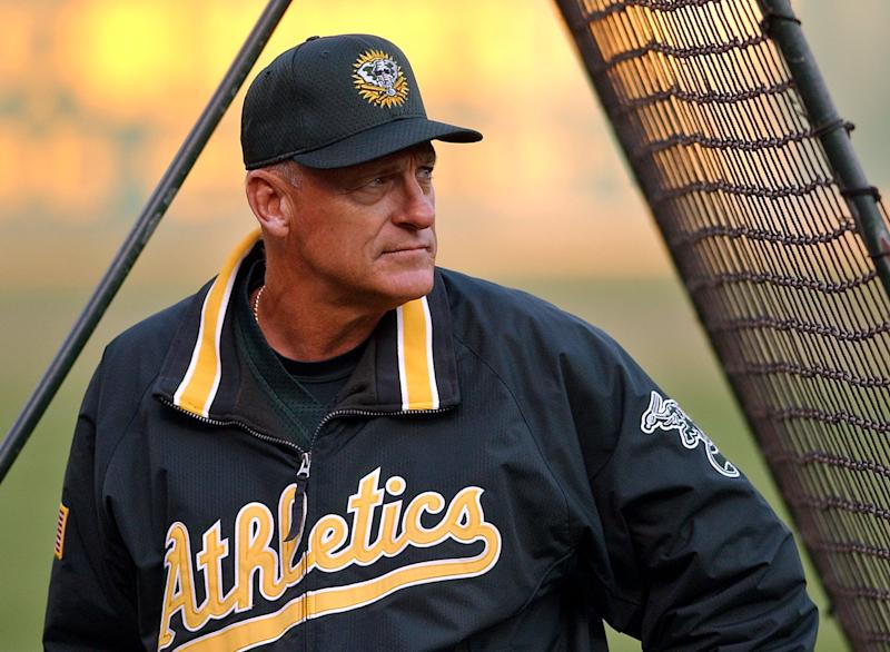 Oakland Athletics manager Art Howe watches over warm-up tosses by starting pitcher Tim Hudson (not shown) during practice for their playoff game with the Minnesota Twins Monday, Sept. 30, 2002, in Oakland, Calif. (AP Photo/Ben Margot)
