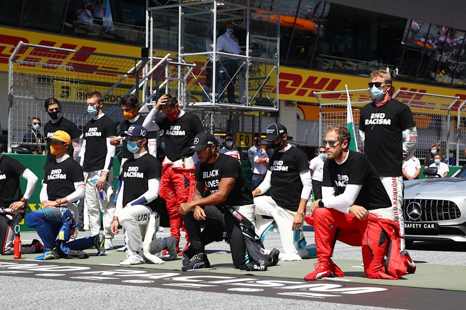 SPIELBERG, AUSTRIA - JULY 05: Lewis Hamilton of Great Britain and Mercedes GP and some of the F1 drivers take a knee on the grid in support of the Black Lives Matter movement ahead of the Formula One Grand Prix of Austria at Red Bull Ring on July 05, 2020 in Spielberg, Austria. (Photo by Mark Thompson/Getty Images)