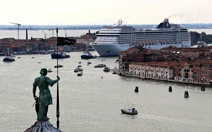The MSC Orchestra cruise ship sailed across the basin as it left Venice yesterday - MIGUEL MEDINA/AFP