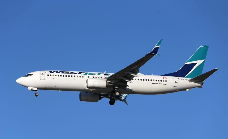 FILE PHOTO: A WestJet Boeing 737 airplane prepares to land at Vancouver's international airport in Richmond,