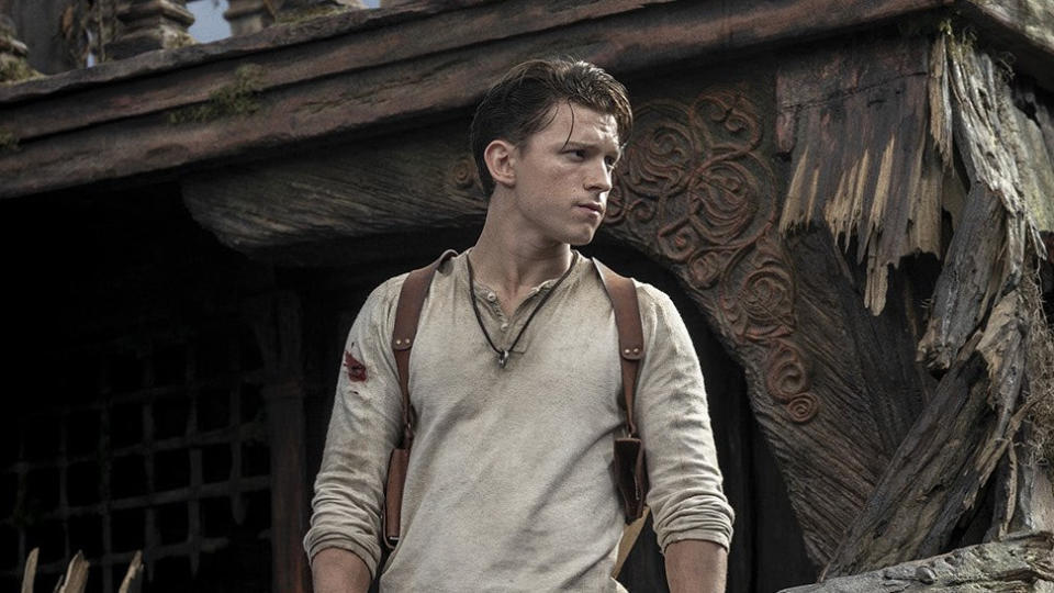 """Having cycled through something like half a dozen directors on its route to the big screen, <a href=""""https://uk.movies.yahoo.com/tom-holland-says-uncharted-will-cure-the-video-game-movie-curse-205632652.html"""" data-ylk=""""slk:video game adaptation;outcm:mb_qualified_link;_E:mb_qualified_link;ct:story;"""" class=""""link rapid-noclick-resp yahoo-link"""">video game adaptation</a> <em>Uncharted</em> has been a long time coming. Tom Holland steps into the shoes of treasure hunter Nathan Drake, with Mark Wahlberg as his mentor Sully. Voice actor Nolan North has given his blessing to Holland's take on the character and shooting wrapped in October. (Credit: Sony)"""