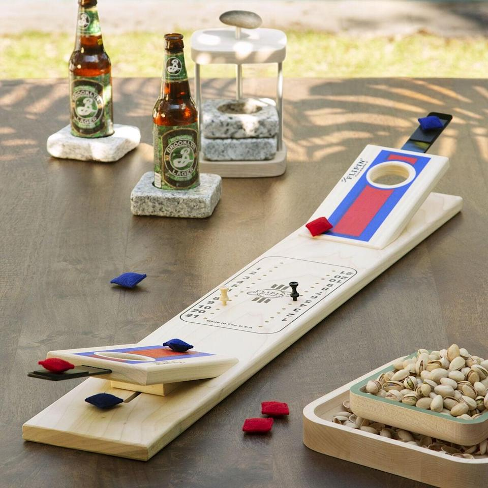 <p>The <span>Tabletop Cornhole</span> ($48) is perfect for having outdoor fun, indoors! </p>