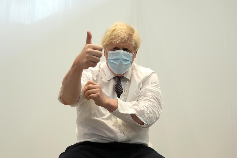 LONDON, ENGLAND - JUNE 03:  British Prime Minister Boris Johnson gives a thumbs up after receiving his second dose of the AstraZeneca coronavirus vaccine from James Black, at the Francis Crick Institute on June 03, 2021 in London, England. More than half of all adults in the United Kingdom have received their second dose of a coronavirus vaccine. (Photo by Matt Dunham - WPA Pool/Getty Images)