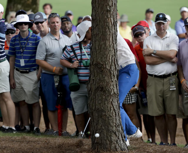 "<a class=""link rapid-noclick-resp"" href=""/pga/players/7542/"" data-ylk=""slk:Jason Day"">Jason Day</a> hits from behind a tree on the 18th hole during the third round of the PGA Championship. (AP)"