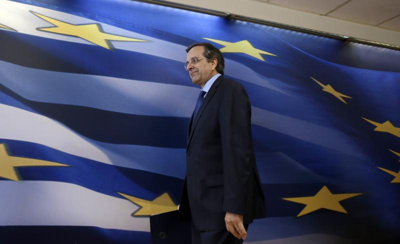 Greece's Prime Minister Antonis Samaras arrives to make a statement to the media at the Finance Ministry in Athens, on Tuesday, March 18, 2014. Greece says it has reached an agreement with its international debt inspectors that will allow the release of a long-delayed rescue loan installment. Samaras said Tuesday that the agreement does not include the requirement for any new austerity measures. Finance Minister Yannis Stournaras said the text of the deal was being written up. (AP Photo/Thanassis Stavrakis)