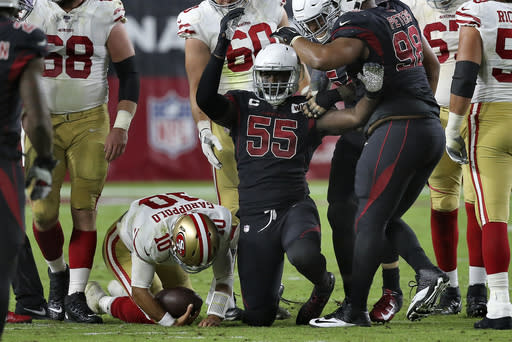 Arizona Cardinals linebacker Chandler Jones (55) celebrates his sack of San Francisco 49ers quarterback Jimmy Garoppolo (10) during the second half of an NFL football game, Thursday, Oct. 31, 2019, in Glendale, Ariz. (AP Photo/Ross D. Franklin)