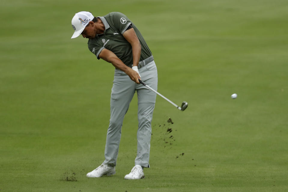 Rickie Fowler hits form the fairway on the 18th hole during the third round of the World Golf Championship-FedEx St. Jude Invitational Saturday, Aug. 1, 2020, in Memphis, Tenn. (AP Photo/Mark Humphrey)