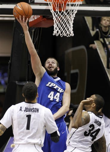 IPFW forward Trey McCorkle (44) gets a bucket in front of Purdue guard Anthony Johnson, left, and forward Jacob Lawson in the first half of an NCAA college basketball game in West Lafayette, Ind., Tuesday, Dec. 20, 2011. (AP Photo/Michael Conroy)