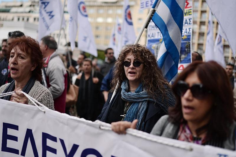 Protesters join a rally against social security reforms in central Athens on December 3, 2015 as unions stage a 24-hour general strike Greek unions paralysed public services and transport today with a general strike over a planned social security overhaul -- the second walkout in less than a month. The action hit trains, shipping and ferry services to Greek islands while hospitals were operating with emergency staff only. (AFP Photo/Louisa Gouliamaki)