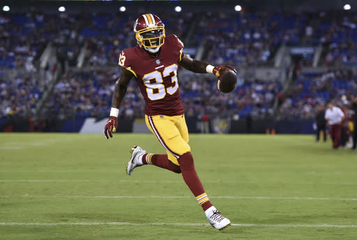 Washington Redskins wide receiver Brian Quick reacts as he scores a touchdown in the first half of a preseason NFL football game against the Baltimore Ravens, Thursday, Aug. 30, 2018, in Baltimore. (AP Photo/Gail Burton)