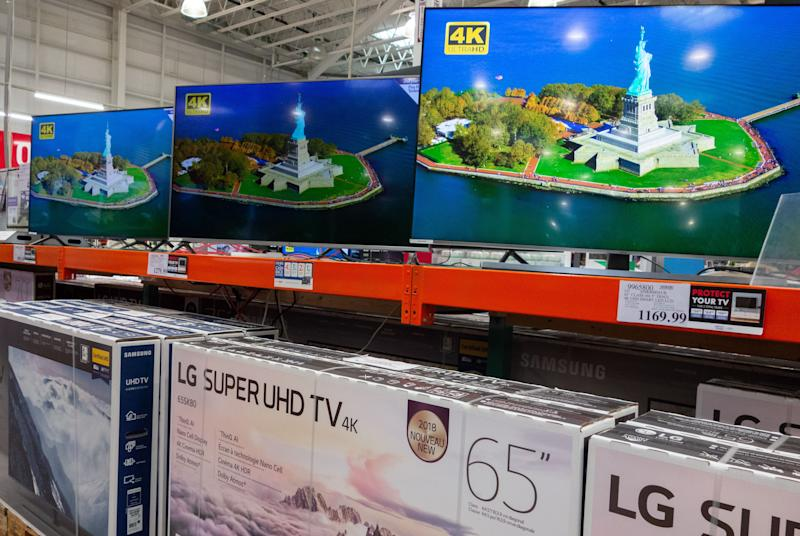 High definition televisions are seen for sale at a Costco store in Washington, DC, September 27, 2018. - A universe of Chinese-made goods found in every American home is now subject to the sprawling tariffs imposed by President Donald Trump, with the brunt of costs to be borne by US consumers, key drivers of the American economy. (Photo by SAUL LOEB / AFP) (Photo credit should read SAUL LOEB/AFP via Getty Images)
