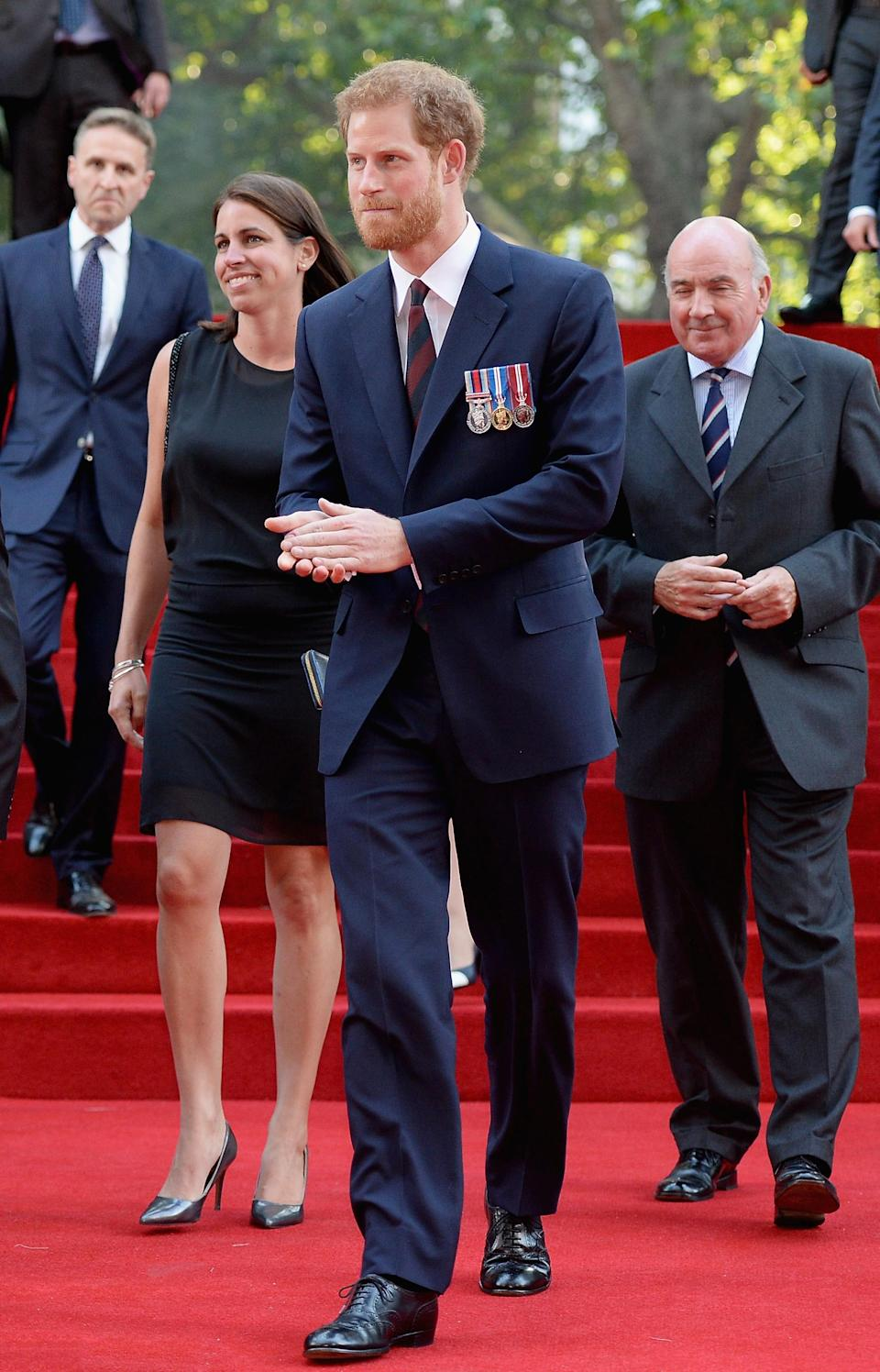 <p>Prince Harry mingled with the stars – including Tom Hardy and Harry Styles – at the premiere decked in a navy suit with his medals on show. <em>[Photo: Getty]</em> </p>