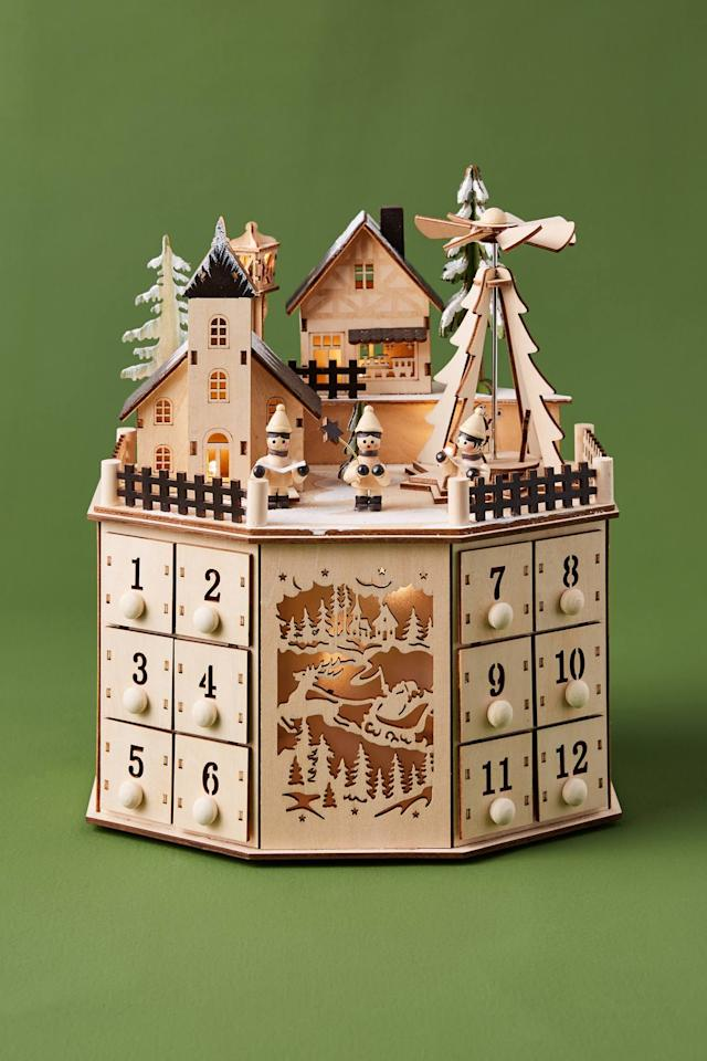 "<p>Hide treats and treasures inside the 24 tiny drawers of this <a href=""https://www.popsugar.com/buy/Village-Advent-Calendar-502217?p_name=Village%20Advent%20Calendar&retailer=anthropologie.com&pid=502217&price=158&evar1=casa%3Aus&evar9=46615300&evar98=https%3A%2F%2Fwww.popsugar.com%2Fhome%2Fphoto-gallery%2F46615300%2Fimage%2F46767575%2FVillage-Advent-Calendar&list1=shopping%2Canthropologie%2Choliday%2Cchristmas%2Cchristmas%20decorations%2Choliday%20decor%2Chome%20shopping&prop13=mobile&pdata=1"" rel=""nofollow"" data-shoppable-link=""1"" target=""_blank"" class=""ga-track"" data-ga-category=""Related"" data-ga-label=""https://www.anthropologie.com/shop/village-advent-calendar?category=holiday-gifts-ornaments-decor&amp;color=013"" data-ga-action=""In-Line Links"">Village Advent Calendar</a> ($158).</p>"