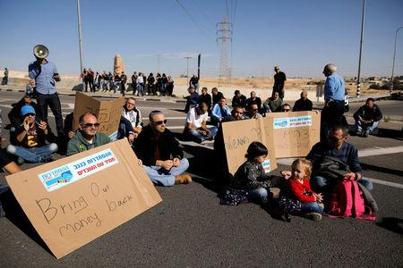 REFILE - CORRECTING DATE Worker of Teva Pharmaceutical Industries block a road during a demonstration near the facility in Neot Hovav, southern Israel December 17, 2017. REUTERS/Amir Cohen