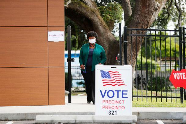 PHOTO: A voter exits the polling precinct after casting their ballot in Florida's primary election at Precinct 321 on Aug. 18, 2020 in Tampa, Fla. (Octavio Jones/Getty Images)