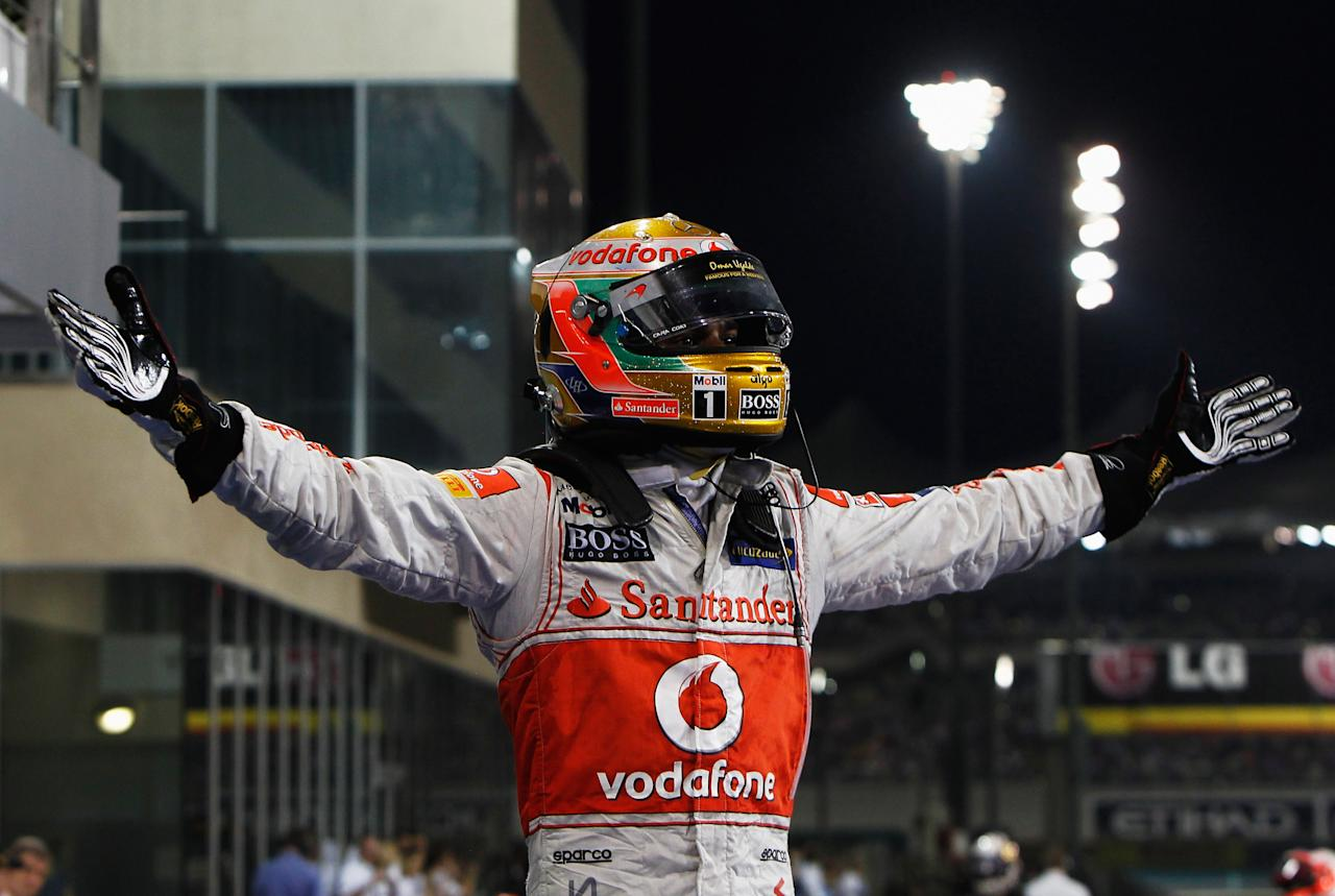 ABU DHABI, UNITED ARAB EMIRATES - NOVEMBER 13: Lewis Hamilton of Great Britain and McLaren celebrates in parc ferme after winning the Abu Dhabi Formula One Grand Prix at the Yas Marina Circuit on November 13, 2011 in Abu Dhabi, United Arab Emirates. (Photo by Hoch Zwei/Getty Images)