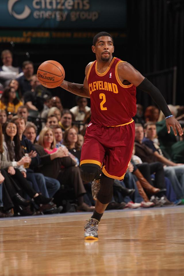 INDIANAPOLIS - DECEMBER 31: Kyrie Irving #2 of the Cleveland Cavaliers dribbles up the court against the Indiana Pacers at Bankers Life Fieldhouse on December 28, 2013 in Indianapolis, Indiana. (Photo by Ron Hoskins/NBAE via Getty Images)