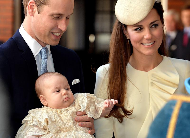 Britain's Prince William, Duke of Cambridge and his wife Catherine, Duchess of Cambridge, arrive with their son Prince George of Cambridge at Chapel Royal in St James's Palace in central London on October 23, 2013