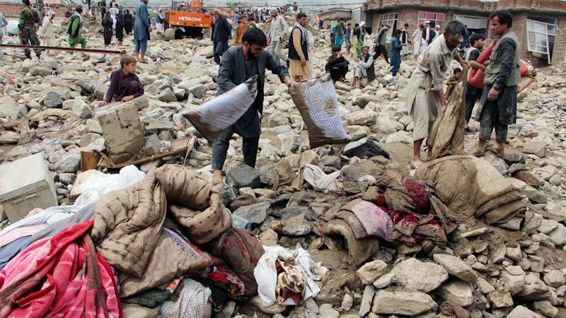 Flash floods in Afghanistan kill at least 100 and destroy hundreds of homes