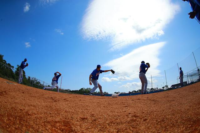 <p>New York Mets minor league pitchers work during a bullpen at the Mets' minor league complex in Port St. Lucie, Fla., on March 2, 2018. (Photo: Gordon Donovan/Yahoo News) </p>