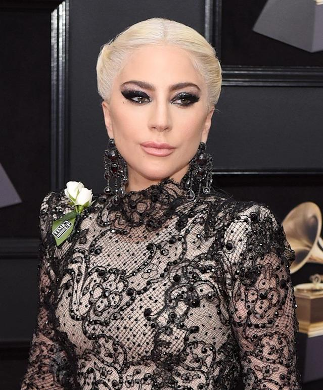 "<p>Sarah Tanno, the global artistry ambassador for Marc Jacobs Beauty, decked out <a href=""https://www.yahoo.com/lifestyle/lady-gagas-grammys-eye-makeup-surprising-inspiration-heres-get-063443831.html"" data-ylk=""slk:Gaga's eyelids in a gothic cat eye"" class=""link rapid-noclick-resp"">Gaga's eyelids in a gothic cat eye</a> inspired by a ""dark, starry night."" To complete the look, she dressed up her pucker with <a href=""https://www.sephora.com/product/poutliner-longwear-lip-pencil-P392349"" rel=""nofollow noopener"" target=""_blank"" data-ylk=""slk:Marc Jacobs Beauty Poutliner Longwear Lip Liner Pencil in Prim(rose) 304"" class=""link rapid-noclick-resp"">Marc Jacobs Beauty Poutliner Longwear Lip Liner Pencil in Prim(rose) 304</a> ($24). (Photo: Presley Ann/Patrick McMullan via Getty Images) </p>"