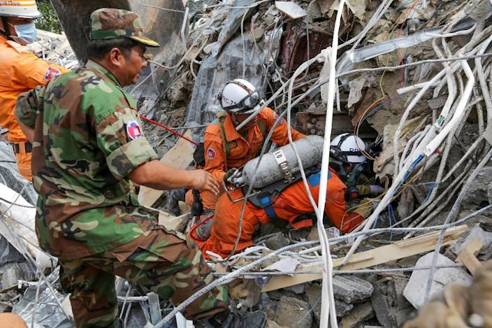Three Chinese nationals and a Cambodian landowner have been held for questioning over the building collapse (AFP Photo/SUN RETHY Kun)