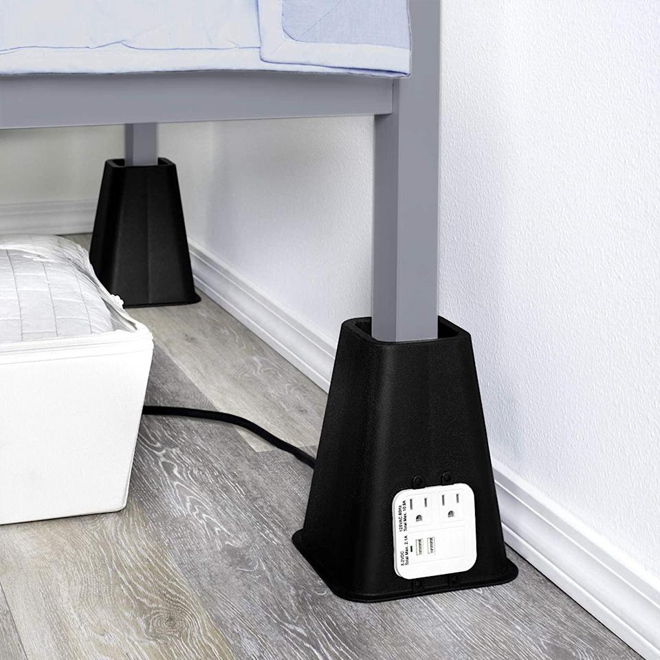 "<p>Using bed risers to gain extra storage space under your sleeping area is a time-honored dorm room trick—but opting for risers with outlet and USB ports, which connect to a power source at the wall, means you won't lose access to precious plug locations under the bed.</p> <p><strong><em>Shop Now:</em></strong><em> Hold'n Storage Bed Risers with Power Outlet and USB Ports, $31.87 for set of 4, <a href=""https://www.amazon.com/Bed-Risers-Power-Outlet-Ports/dp/B0883F3DSD/ref=as_li_ss_tl?ie=UTF8&linkCode=ll1&tag=mslhome21dormstorageideasbcopelandjul20-20&linkId=7bc032a238fc4b1e1b8ade7f797b14e6"" rel=""nofollow noopener"" target=""_blank"" data-ylk=""slk:amazon.com"" class=""link rapid-noclick-resp"">amazon.com</a>.</em></p>"